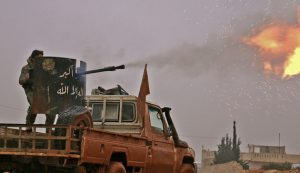 TOPSHOT - Syrian opposition fighters fire towards positions held by Islamic State (IS) group jihadists in al-Bab on the northeastern outskirts of the northern embattled city of Aleppo on December 13, 2016.  / AFP / Saleh ABO GHALOUN        (Photo credit should read SALEH ABO GHALOUN/AFP/Getty Images)