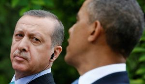 FILE PHOTO -  Turkish Prime Minister Recep Tayyip Erdogan (L) listens as U.S. President Barack Obama (R) addresses a joint news conference in the White House Rose Garden in Washington, May 16, 2013.   REUTERS/Kevin Lamarque/File Photo - RTSEXJC