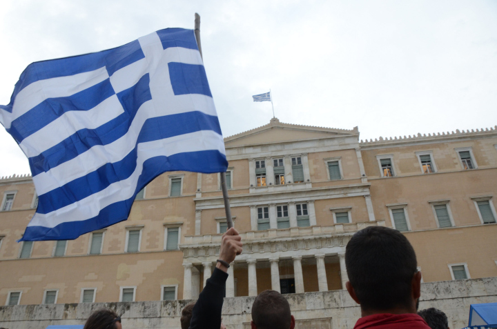A flag raise during demonstration against pension reforms in