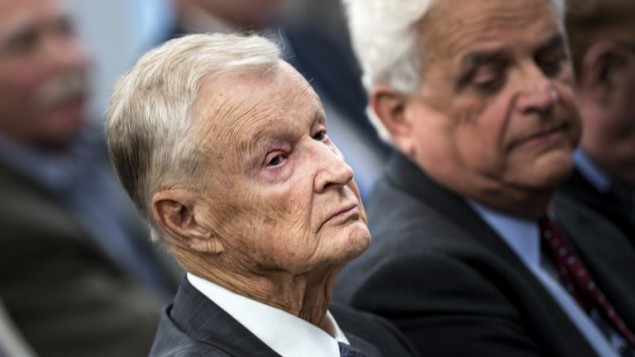 This file photo taken on October 22, 2013 shows former US National Security Adviser Zbigniew Brzezinski (L) listening during a forum discussion at the Johns Hopkins University School of Advanced International Studies in Washington, DC. (AFP/Brendan Smialowski)