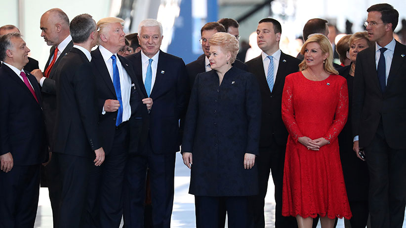 U.S. President Donald Trump adjusts his jacket after pushing past Montenegro Prime Minister Dusko Markovic the NATO Summit in Brussels, Belgium, May 25, 2017. (Kevin Coombs/Reuters)