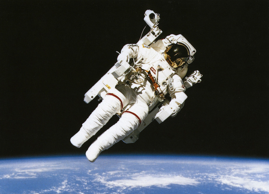 Astronaut floating in orbit above the earth during spacewalk