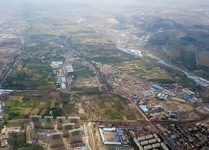 Aerial-view-of-Urumqi-Xinjiang-Province-PR-China-photo-via-Wikimedia-Commons-300×215