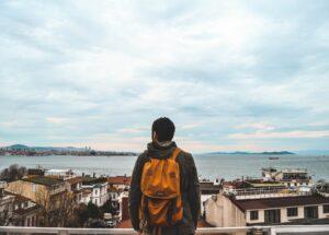 Man-with-backpack-in-Istanbul-Turkey-photo-by-Oziel-Gomez-via-Unsplash-300×215